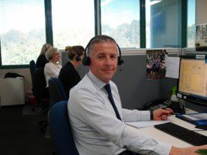 Sales consultant sitting at desk